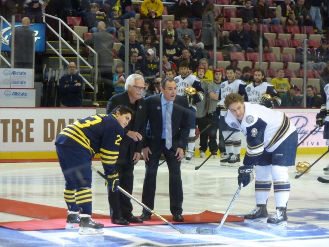 ceremonial puck drop with team captains, current & original commissioners